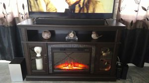 Fireplace TV stand only 6 months old comes with remote control for Sale in Beaverton, MI