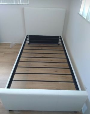 Twin size bed frame and free delivery New in the box for Sale in Miami, FL