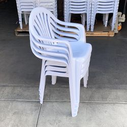 New in box $44 Stacking Plastic Chair Set 4pcs with Armrest Indoor Outdoor Patio Furniture 21x21x31 inches for Sale in Santa Fe Springs,  CA
