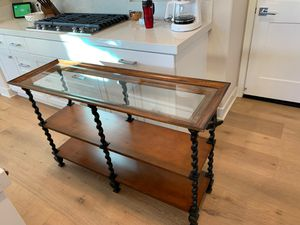 """Sofa table 32"""" H x 52"""" L x 17"""" W. Glass beveled top. Two shelves. Metal twisted bar frame for Sale in Mission Viejo, CA"""