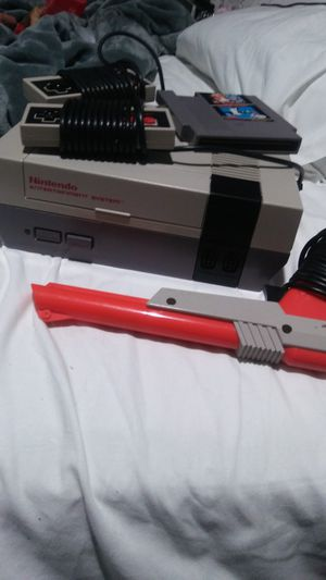 Today only original Super Nintendo with Mario Brothers and Duck Hunt two remote controllers and gun all the plugs to connect it today only $75 for Sale in Long Beach, CA