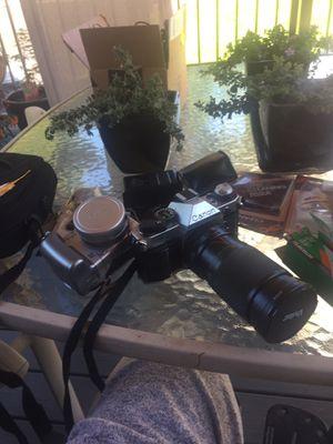 Cameras Canon AE-1 with a Vivitar lense Canon digital Sony Handycam Olympus digital Nikon coolpix for Sale in Arlington, WA