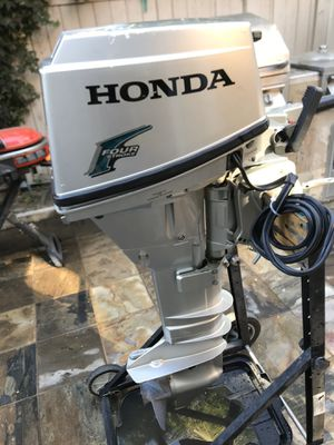 Clean HOnda 15hp 4stroke outboard motor (long shaft) electric start for Sale in Huntington Beach, CA