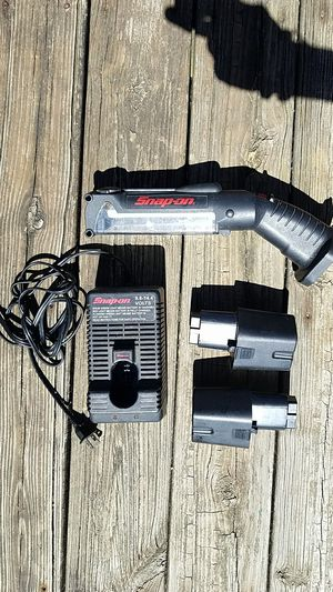 Rechargeable Snap-on flashlight with charger and 2 batteries for Sale in Columbus, OH