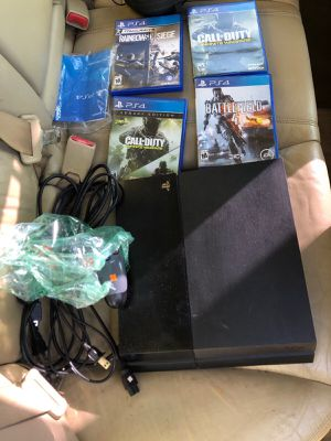 PlayStation 4 (Blue Light , Needs Repair) With Games And Controller for Sale in Miami Shores, FL