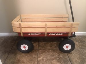Brand new radio flyer wagon is missing one wood piece as shown in picture for Sale in Phoenix, AZ
