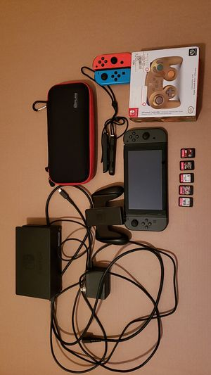 Nintendo switch with 5 games plus accessories for Sale in Providence, RI