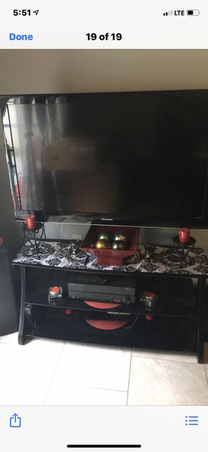 TV and stand for Sale in CHAMPIONS GT, FL