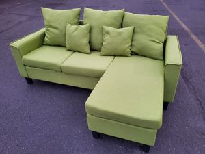 Green Sectional couch, size 7by5ft, reversible chase for Sale in Seattle, WA