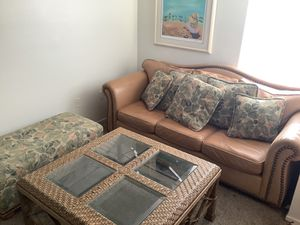 Tropical vacation style sofa bed includes living room table and matching ottoman for Sale in Las Vegas, NV