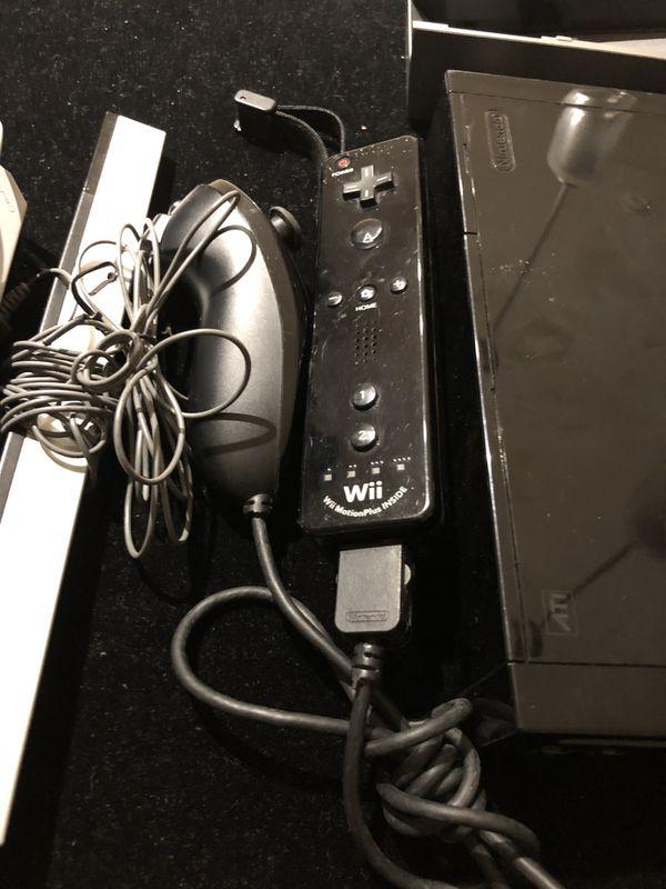 Nintendo Wii Black Console Bundle with Remote/Nun Chuck Combo + Super Mario Bros