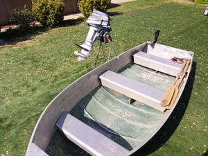 12 feet boat, very light (easy to load on Pick-Up Truck Rack) not leaking with 8 h/p engine (works great), 3gl tank, anchor, oars and fish finder for Sale in Sacramento, CA