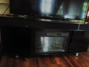 Fire place/surround sysy/tv stand. It holds up to 80 inch tv for Sale in Pittsburgh, PA