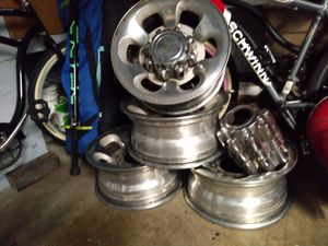"16"" Original ford rims 8 holes with caps for Sale in Santa Ana, CA"