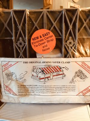 The original awning saver clamp, new never opened, but. box has stains for Sale in Whitehall, PA