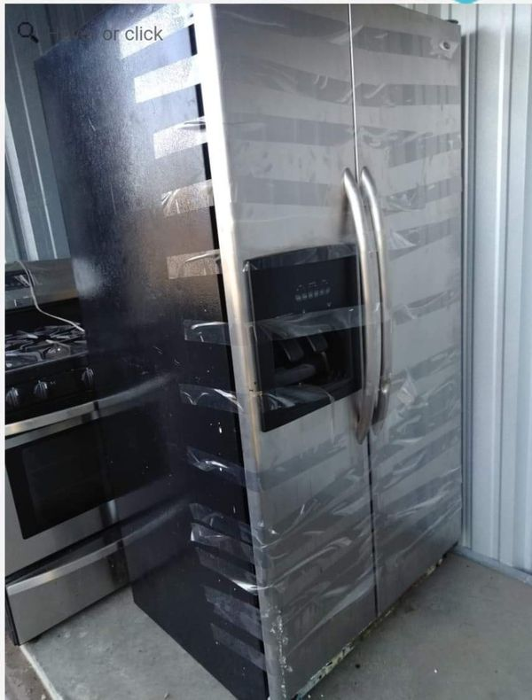 Stainless steel double door refrigerator and stove NO HOLDS PICK UP 1/16 @11