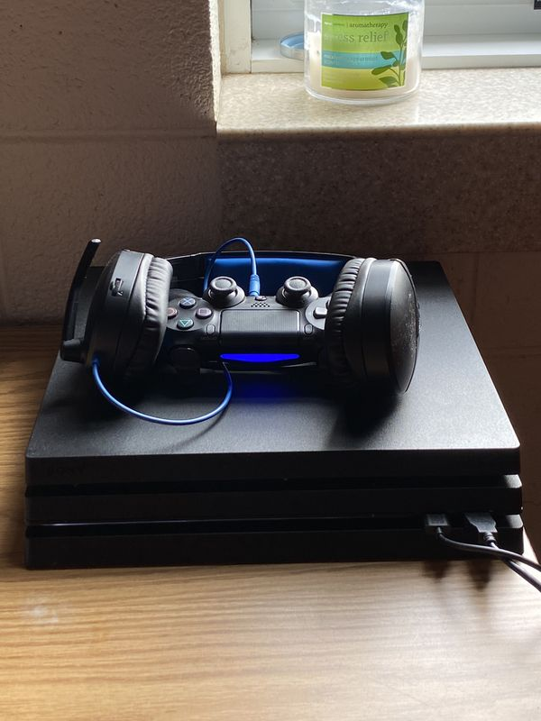 1 TB PS4 Pro, with 2 controllers and turtle beach headset. (PS4 is only 5 months old)