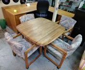 Solid mahogany table with 4 rolling chairs for Sale in San Diego, CA