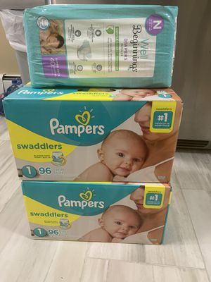 Size 1 pampers and one pack newborn diapers for Sale in Belmont, MA