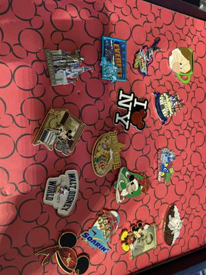 15 Walt Disney World pins in case. for Sale in Temple Hills, MD