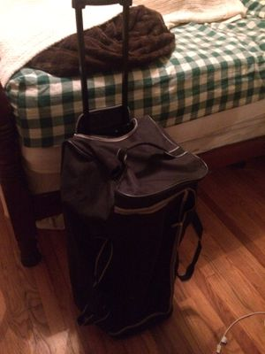 Nice duffle bag with extendable zip up handle and rollers for Sale in Hendersonville, TN