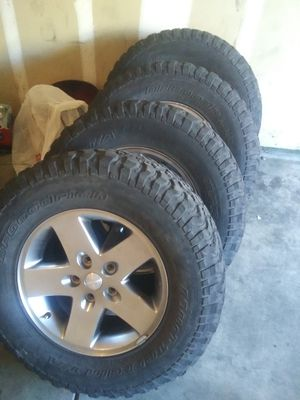 Jeep wheels and tires 80 all 4 for Sale in Las Vegas, NV