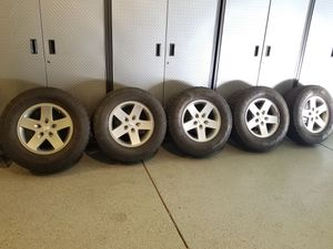 5 tires, four used tires and one new tire, 17 inch rims, Jeep Wrangler. for Sale in Lakewood, CO
