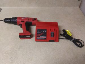 Older Milwaukee 18 volt 1/2 in cordless hammer drill no battery with charger works great for Sale in Lake Stevens, WA