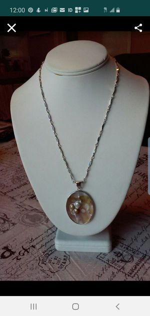 Sell new necklace of sterling silver with oval shell pendant. New condition for Sale in Alhambra, CA