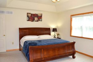 Wooden sleigh kind size bed frame, mattress & two nightstands for Sale in Tobyhanna, PA