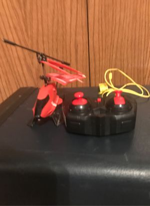 Sky rover Visualante remote controlled helicopter with attachments, charger, and controller in perfect condition nothing wrong looking for offers and for Sale in Sioux Falls, SD