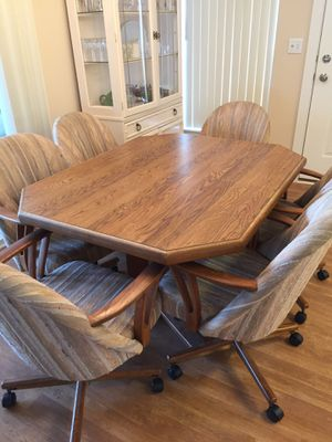 Table with 6 fabric swivel tilt chairs for Sale in Sarasota, FL