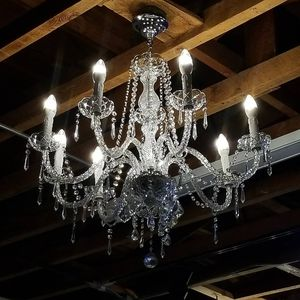 Chandelier about 2 ft 5 wide , 2 ft 3 long look at dimensions of pics for Sale in Ontario, CA