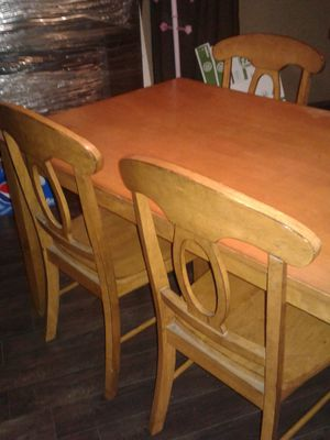 Wood table has 4 chairs good conditon for Sale in Fresno, CA