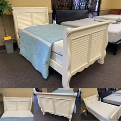 White wood twin size sleigh bed frame with boxspring and memory foam mattress $229.99 Located at Hidden Treasures thrift store 7867 Palm River Rd., Ta for Sale in Tampa,  FL
