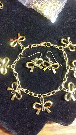 Gold-plated bow bracelet / earrings for Sale in Fresno, CA
