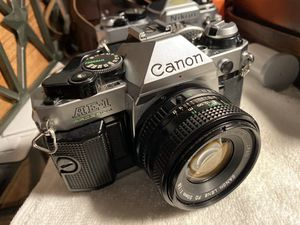 Canon AE1 Program 35 mm slr film camera w canon 50mm f1.8 lens No Squeak Meter works good for Sale in Whittier, CA