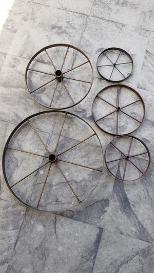 """Wagon wheels (16"""" $20) (12"""" $15) (9"""" $10) (7.5"""" $8) (6.5"""" $5) price is each. for Sale in Tacoma, WA"""