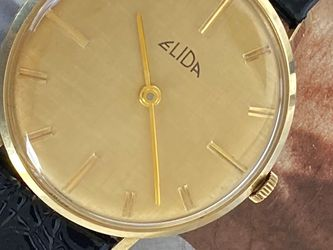 Solid Gold 14k. Elida GENEVE. Swiss Made Hand Winding Movement. 39mm, Leather Band. Pristine Condition. for Sale in Miami,  FL