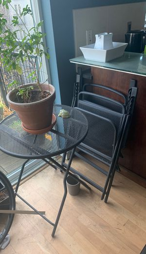 Cast iron table + chairs for Sale in Seattle, WA