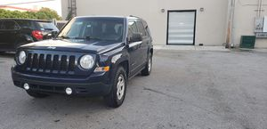 Jeep patriot 2014 rebuilt title very good condition. Real cash price only 28000 miles for Sale in Miami, FL