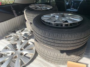 "Honda Civic rims and tires (steel wheels with hubcaps ) 15"" for Sale in South Gate, CA"