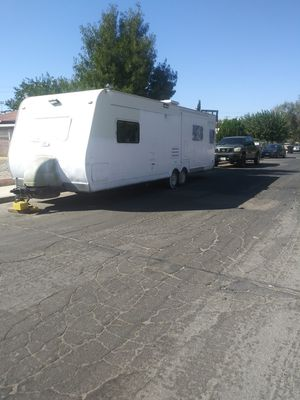Limited time on price 31 ft Rv with pop out tags up-to-date and have title for Sale in Victorville, CA