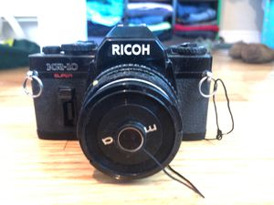 Ricoh KR-10 Super 35mm film camera body and 50mm lens with cap included for Sale in Austin, TX