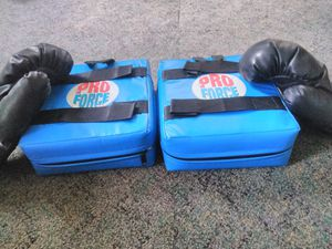 Boxing gloves with pads tennis rackets for Sale in Akron, OH