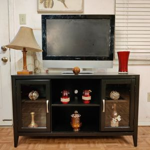 """Nice big TV stand for big TVs with glass cabinets and shelves in good condition, driveway pickup. L48""""*W18""""*H28"""" for Sale in Springfield, VA"""