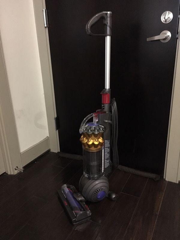 Brand New: Dyson DC65 Multi Floor Upright Vacuum - Bagless - Yellow $200 OBO
