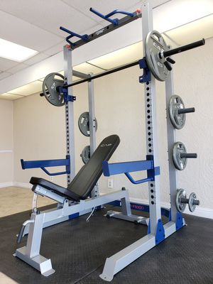 ( EXERCISE FITNESS 365 ) COMPLETE OLYMPIC WEIGHT SET. SQUAT RACK/BENCH PRESS, ADJUSTABLE BENCH, OLYMPIC BARBELL, FULL SET OF OLYMPIC WEIGHTS for Sale in Bellflower, CA