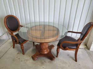 Tommy bahama style table and two chairs for Sale in Bay Lake, FL