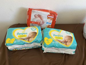 Preemie diapers , deluxe diaper changer and a newborn MAM pacifier for Sale in Oxnard, CA